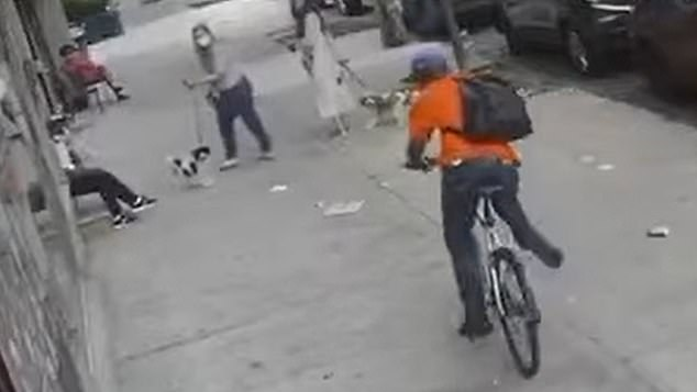 The man tries to get away on the bike, but he is eventually chased down by the firemen