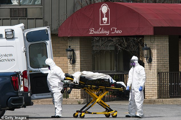 The Andover Subacute Rehabilitation Center II in Lafayette Township, New Jersey, was sued this week by the nephew of a resident who died from coronavirus in April - just before 17 bodies were found crammed into a tiny morgue at the facility. Pictured: Medical workers remove a body from Andover II on April 16