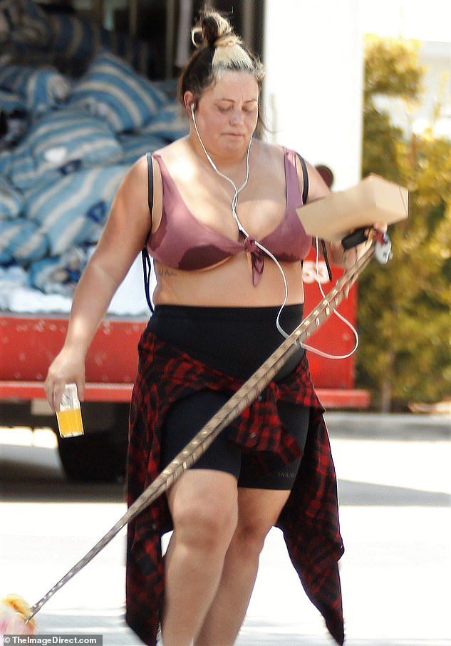 Aubrey was spotted in these photos published last week looking unrecognizable as she emerged for a quiet stroll with her dogs in Palm Springs, California
