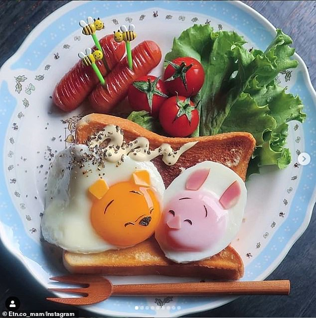 The mother-of-three practises a Japanese art called kyaraben which is a style of elaborately arranged bento (a home-packed meal). Pictured, Winnie the Pooh and Piglet created using eggs