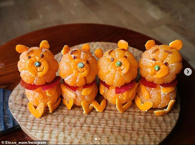 A Japanese mother has become an online sensation after using food to create much-loved film characters for her fussy children. Pictured, a line up of Winnie the Poohs made from oranges