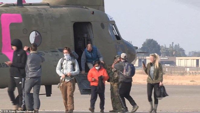 The hikers streamed off the helicopter carrying camping gear.At least 65 more hikers and campers are believed to be trapped near Chinese Peak and Lake Edison as the rescue efforts continue