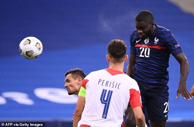 Dayot Upamencano heads in France's third goal from Antoine Griezmann's corner kick