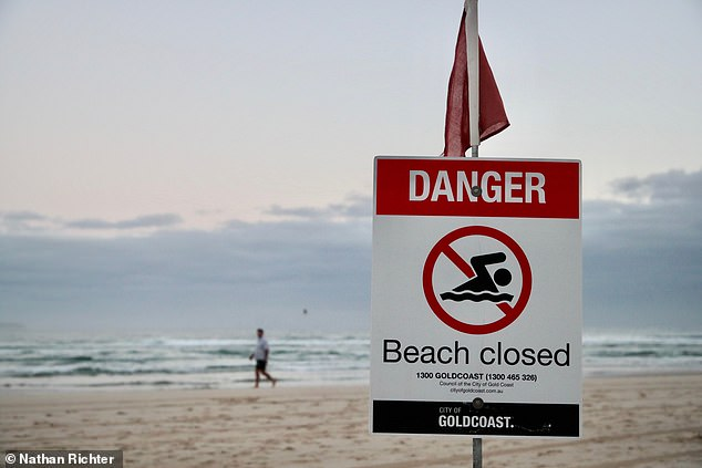 A sign at Greenmount Beach alerts swimmers and surfers that the beach is closed on Wednesday