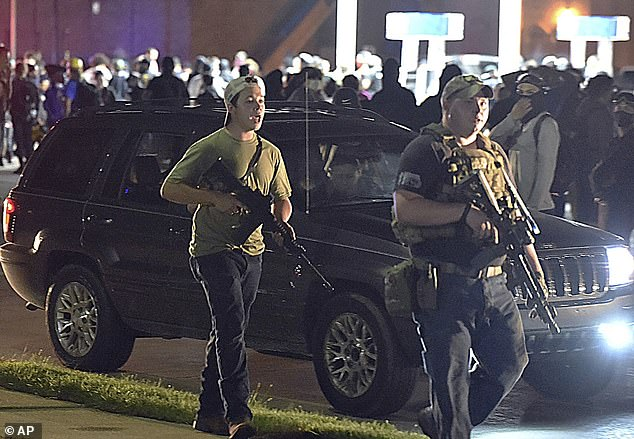Chandwaney said that Facebook failed to remove a militia group's event encouraging people to bring guns to protests in Kenosha following the police shooting of Jacob Blake. Kyle Rittenhouse who shot dead two BLM protesters in Kenosha is pictured (left) on August 25