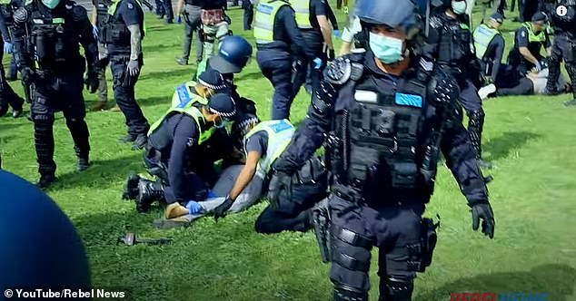 Taxpayers have funded 22,100 new jobs since the start of the coronavirus pandemic despite the worst recession since the 1930s Great Depression. Pictured are Melbourne police tackling Rebel News personality Avi Yemini