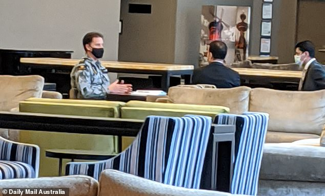 An ADF member appears to conduct a meeting at the Sofitel hotel in Melbourne on Wednesday.