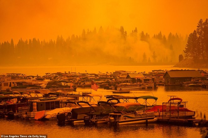 Boats at the Shaver Lake marina are pictured in an orange haze as the Creek Fire continued to blaze in the Californian area