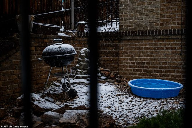 Snow accumulates on a grill and kiddie pool in Denver, Colorado on Tuesday - after a Labor Day weekend of 101 degree heat