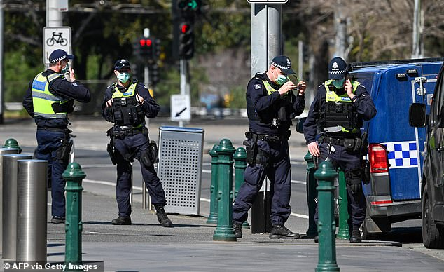 Police officers are also required to wear face masks in Melbourne during the state's strictest lockdown (pictured on September 6)