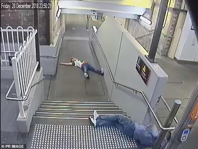 CCTV footage shows the pair splayed out on the concrete floor of a 'filthy railway underpass' just before the assault