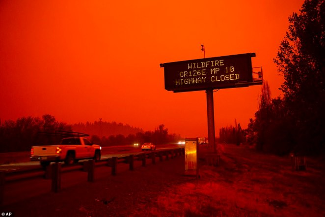 A sign along Interstate 5 north of Eugene, Oregon, warns drivers on Tuesday that Highway 126 eastbound is closed