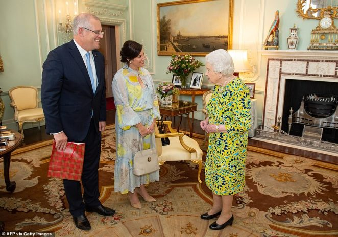 The mother-of-two made a similarly striking statement by wearing a floral, balloon-sleeved Ginger & Smart midi-dress to meet Her Majesty Queen Elizabeth II in December 2019