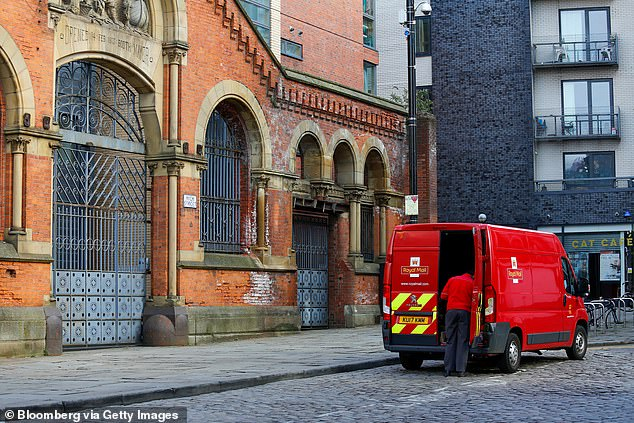 Royal Mail has faced resistance over plans to deliver fewer letters and refocus its energy on its parcel delivery service - which has boomed during lockdown. Pictured, a postman in Manchester on April 8