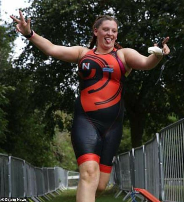 When Miss Horton was working in the supermarket, she bent over to pick something up when her back gave in and she had to be rushed to hospital. Pictured during a triathlon