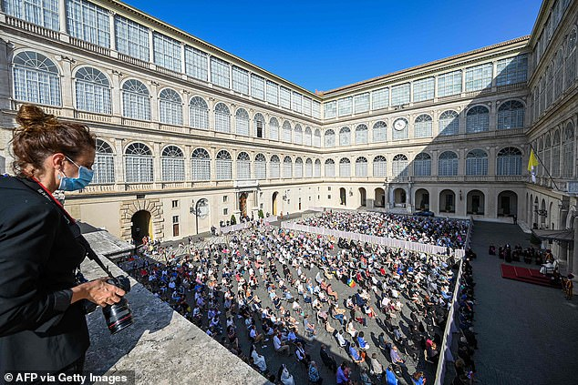A photographer looks on as a general view shows the San Damaso courtyard as Pope Francis holds a limited public audience in The Vatican on September 9, 2020