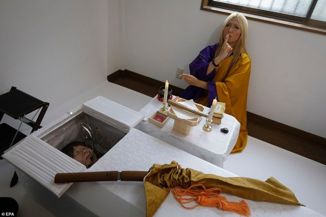 A Japanese samurai sword, ceremonially given to the dead to protect themselves from evil spirits on their way to the afterlife world, is placed on a coffin