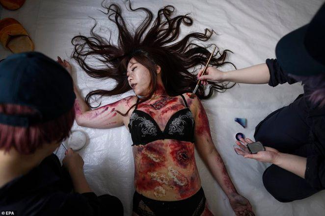 Megumi Kazuki dresses up as a murder victim at the unusual laboratory where customers can fulfil their darkest fantasies