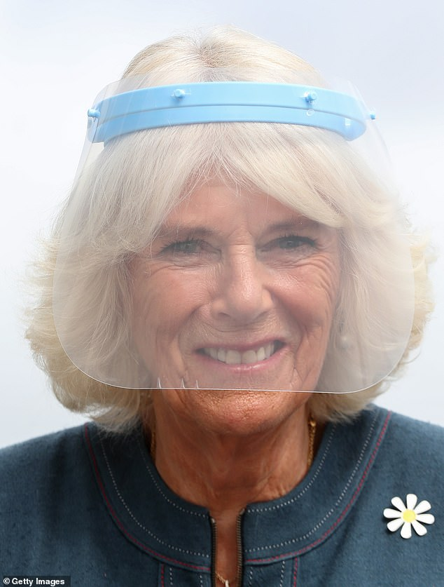 The royal donned a full length plastic visor and a daisy-themed brooch to the training centre visit