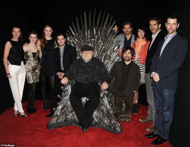 Martin, who is currently working on the sixth Game of Thrones novel, The Winds of Winter, has sold more than 20 million books worldwide and is worth an estimated $65 million. But despite his vast fortune, the fantasy icon lives between two modest houses on the same street in Santa Fe, his home since 1979. Pictured: Martin with HBO's cast and team of Game of Thrones