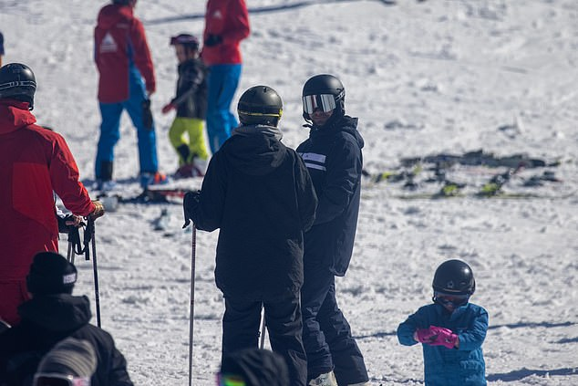 Whiteout! Zac looked comfortable on the slopes as he chatted with Vanessa as other skiers went round the pair