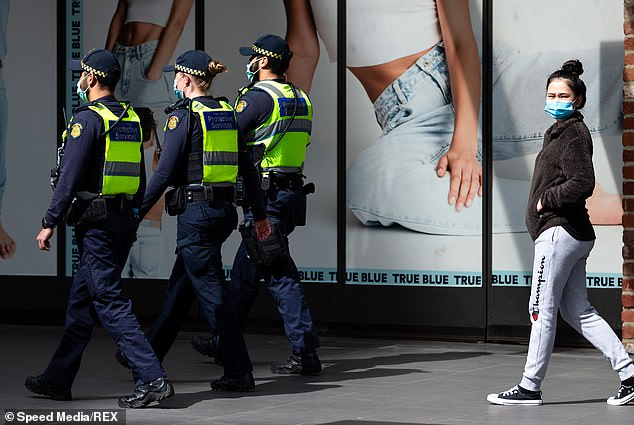 Police patrol Bourke Street Mall during Stage Four COVID-19 restrictions in Melbourne on Wednesday.Stage Four lockdown will continue for another two weeks beyond September 13