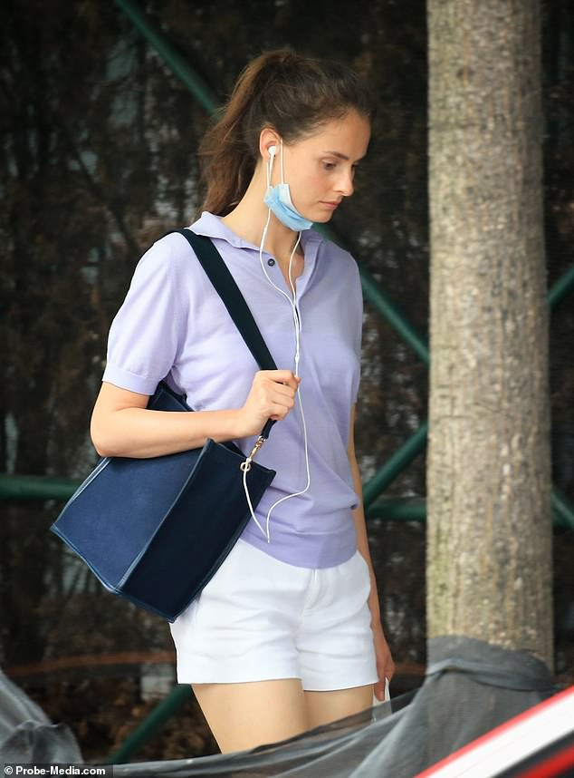 The 31-year-old dressed casually in white shorts and a lilac polo shirt, with her long brown hair pulled back into a loose ponytail