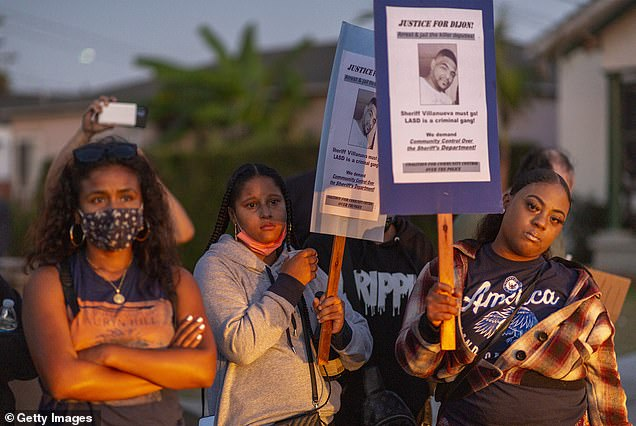 Protesters at a makeshift memorial in LA last week following the shooting death of Dijon Kizzee by cops