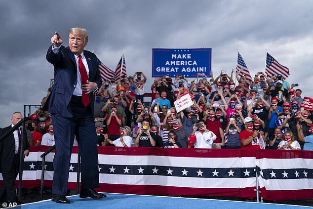 Trump spoke to thousands in Winston-Salem on Tuesday. Some attendees, like those behind him here, wore masks, but many in the crowd were maskless
