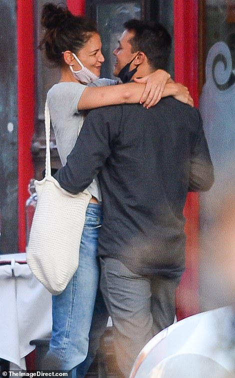 No hiding: Katie, 41, and Emilio, 33, appear to be head over heels in love as they are spotted kissing outside his father's restaurant in New York City on Tuesday