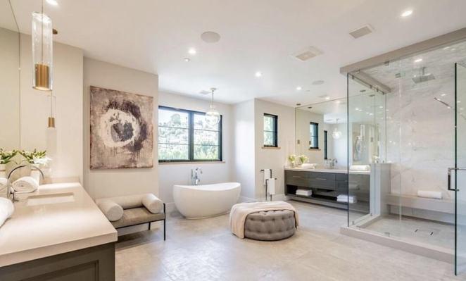 Splish splash! The bathroom has a freestanding bathtub and glass-enclosed shower