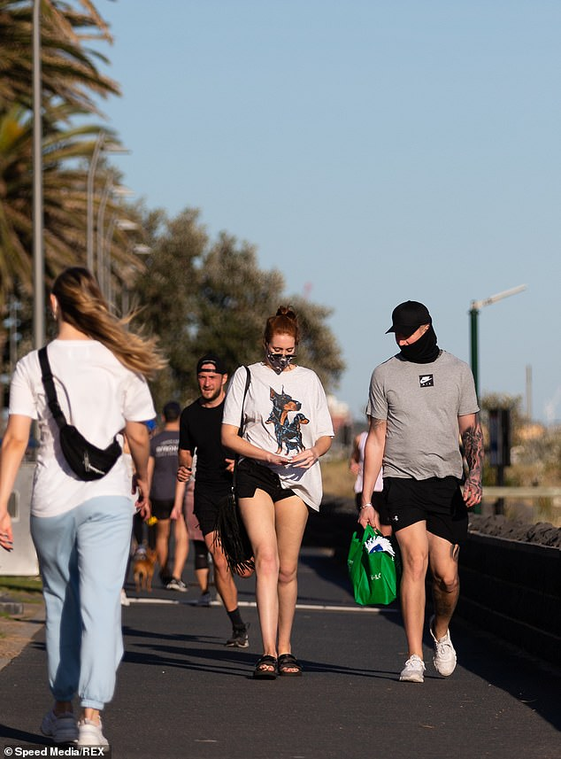 Locals enjoy the warmer spring Melbourne weather despite the wind during COVID-19 in Melbourne, Australia