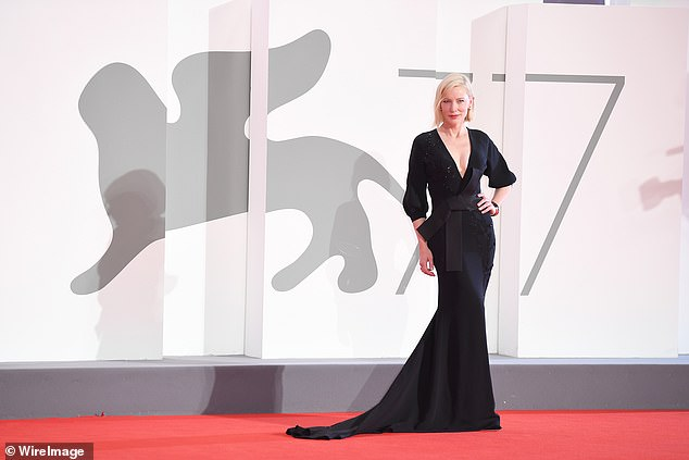 Showstopping: Cate's stunning black dress featured sequin details, a long train, and a chunky black belt that tightened her waist