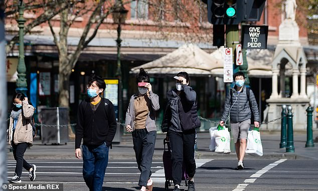 The road map out of Melbourne lockdown has been described as a crushing policy by one businessman. Pictured are Melburnians soaking up the sunshine in the CBD on Thursday