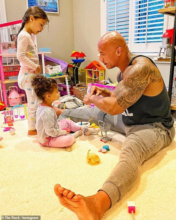 Voting father: 'He absolutely loves his girls.  They stay out of the spotlight, so their girls can have a normal childhood, 'said an insider from The in the Rock