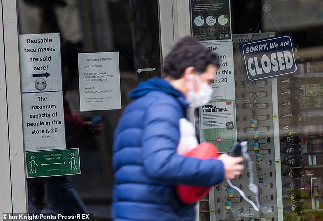 Mr Andrews' 'roapmap to reopening' has been slammed by fellow politicians as being too strict. A man walks past a closed shop on Swanston Street on September 9, 2020 in Melbourne, Australia
