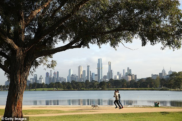 Melbourne is home to seven of Australia's ten worst postcodes for mortgage stress where home borrowers can't service their loan and pay their bills on time. Pictured are people exercising at Albert Lake in inner Melbourne