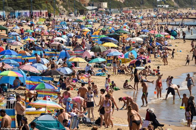 A maximum temperature of 81F (27C) is expected in London on Monday, while many areas of southern England and East Anglia could reach 77F (25C). Pictured: Bournemouth on August 7