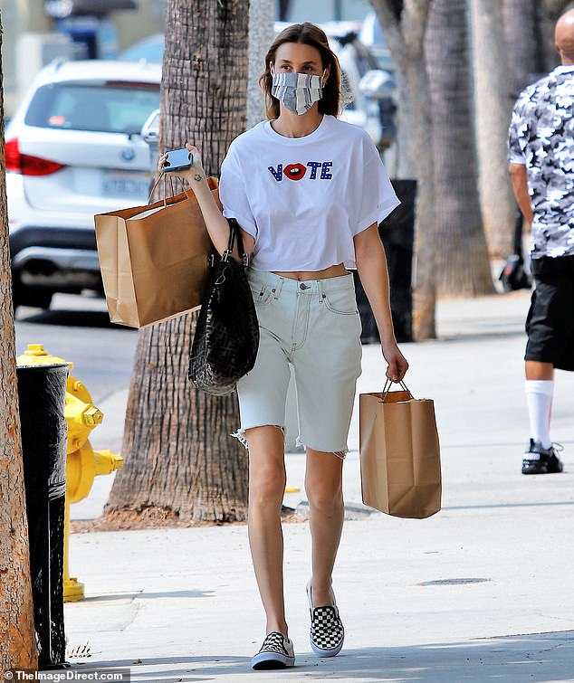 Stocking up: Whitney Port, 35, looked sporty and casual in a white 'Vote' T-shirt while going shopping Wednesday in Los Angeles' Studio City neighborhood