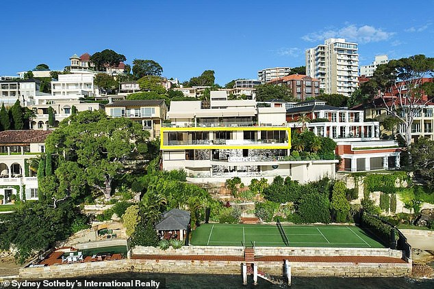 The spectacular five-storey Point Piper property (pictured) called 'Edgewater' features a private jetty, tennis court, and huge terraces on each level overlooking Sydney Harbour