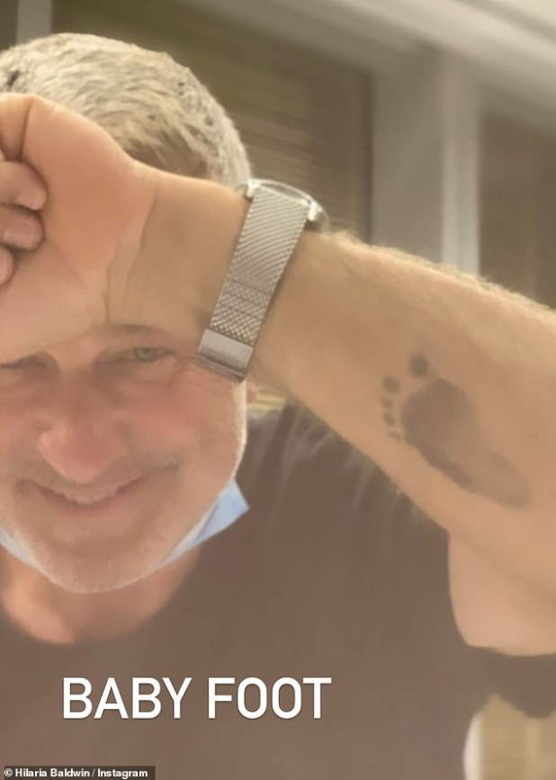 Proud Papa: He became a father for the sixth time on Tuesday night.  And on Wednesday night, Alec Baldwin, 62, showed a trace of his latest hair ink stamped on his arm