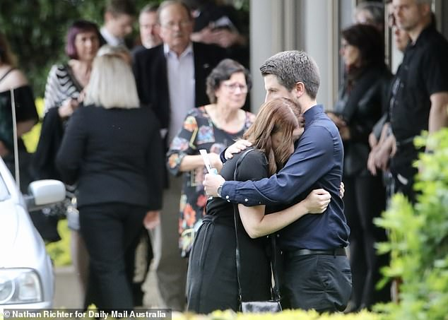 Devastated mourners embraced at the funeral at Mount Gravatt on Thursday afternoon after Ms Caisip was banned from attending