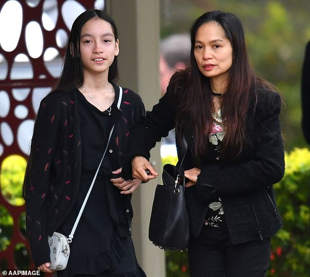Ms Caisip was granted a private viewing of her father's body, surrounded by security guards and without being allowed to see her mother and 11-year-old sister (both pictured)