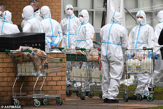 Firefighters planning to take food into Melbourne towers suspected of having COVID-19 took no chances in July