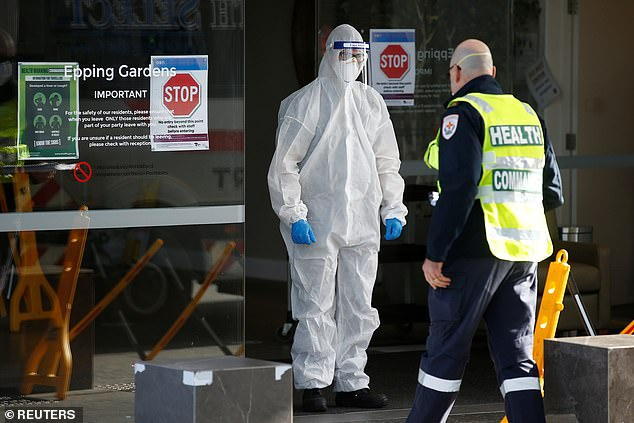 Health workers prepare to enter a COVID-19 infected aged care facility in July