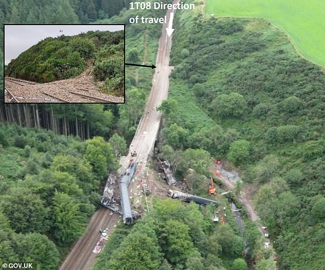 Heavy rainfall that washed material onto the track - a 'significant contributing factor' to the tragedy (pictured) - was aided by a steep, sloped area to the side of the initial derailment point