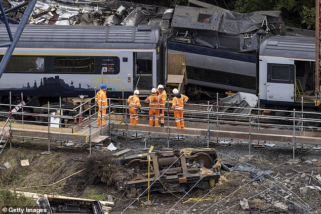 A 600-tonne crawler crane is being used to lift the derailed carriages from the railway line today