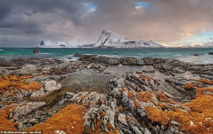 'God's Eyes' by Jan Smid, a Czech landscape photographer based in Prague. The stunning coastline was pictured in the Lofoten Islands of Norway