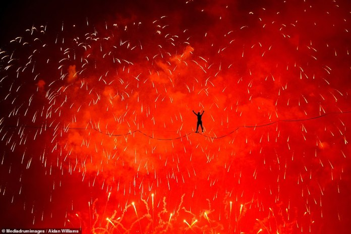 'Inferno' by Aidan Williams. The photographer from New South Wales, Australia, took the picture as fireworks went off during slack line walking at the Zurichfest in Switzerland
