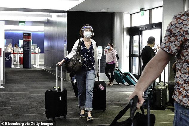 The first case of coronavirus in Los Angeles was not detected until January 26, when a passenger flying through LAX (airport pictured; patient not pictured) was whisked away to isolation
